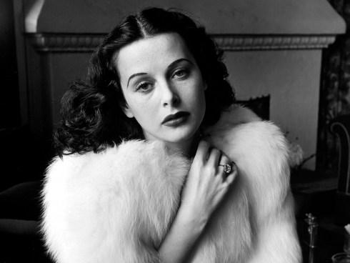 Glamorous portrait of movie actress Hedy Lamarr wearing white fox fur short jacket.1938