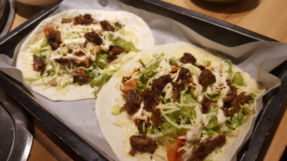 K-taco - It's fresh lettuce, kimchi, sour cream, cheese, and your choice of Korean barbecue meat. Yum!