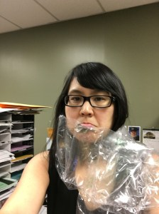 photo of monica in plastic and paper wrap
