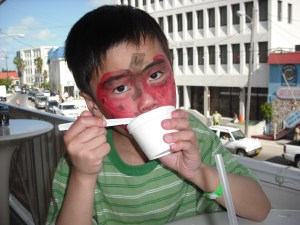 photo of kid with strawberry painted on his face