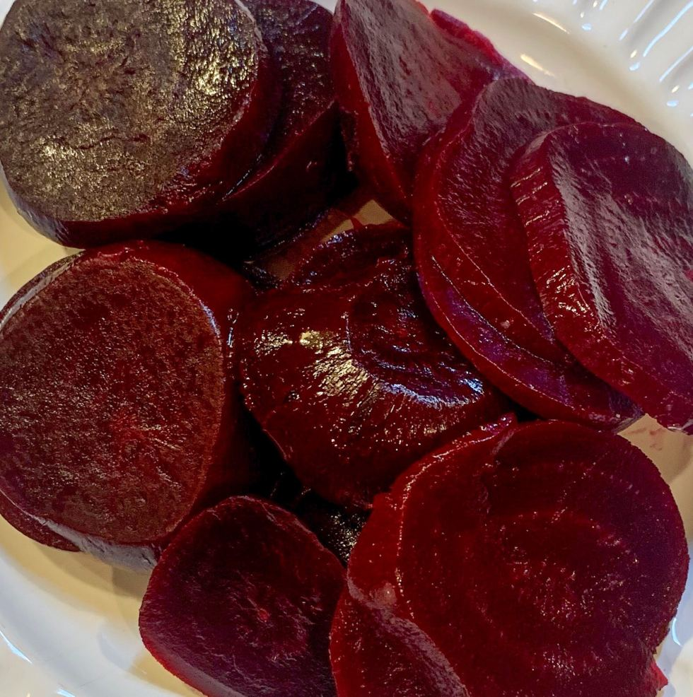Close up shot of Lazy Roasted Beets on a white plate.