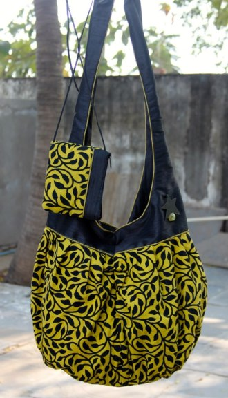 a.ku designs green and black floral bag