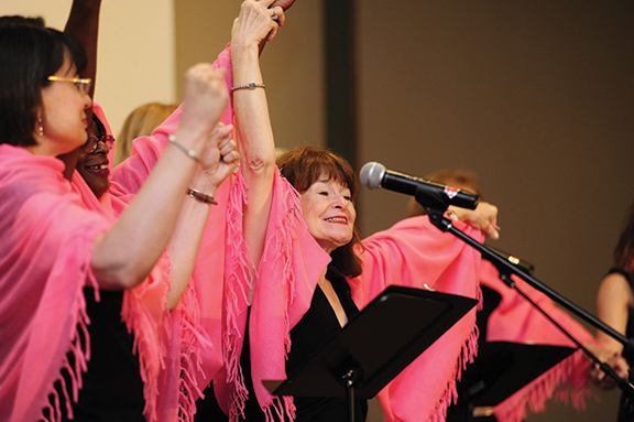 Members of the Keeler Women's Center Theatre Troupe perform a song celebrating women for the 10th anniversary of the ministry. The center supports women of urban Kansas City, Kan.