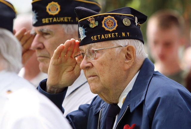 A U.S. military veteran salutes during a Memorial Day service in Setauket, N.Y., in May. Veterans Day, observed annually Nov. 11, honors all those who have served in the U.S. armed forces. (CNS photo/Gregory A. Shemitz)