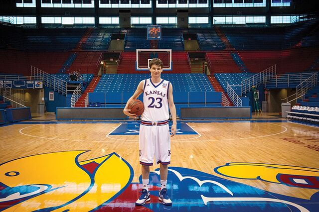 """Chris Huey models his very own uniform in Allen Field House in Lawrence. Huey had """"a dream come true"""" when he suited up and played against TCU on Feb. 21."""