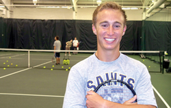 Leaven photo by John Shultz Last fall, St. Thomas Aquinas senior Christian Boschert launched a foundation to teach tennis skills to Special Olympic athletes. He is pictured above at a January clinic in Overland Park.