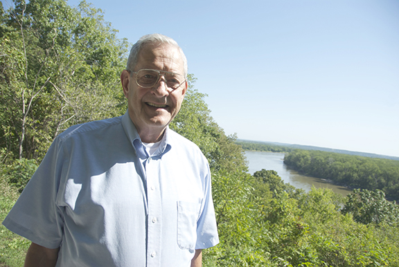 Elmer Fangman stands over the bend in the Missouri River near Benedictine College's campus. Fangman oversaw the merger of St. Benedict's College and Mount St. Scholastica College while he was dean of students at St. Benedict's.