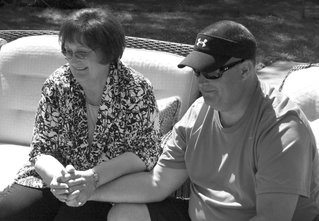 """Paula Alwin and David Hattaway, a parishioner of St. Joseph Church in Shawnee, met this spring after 45 years. Alwin gave birth to him in 1966 and placed the baby for adoption, believing she would never know him. Hattaway wanted to know more about her and searched for her this year. They began writing letters, made phone calls, and finally met in person. """"Before we met, I see that God really allowed us to get to know each other,"""" Alwin said. They found they bear striking physical similarities and have many shared interests.  (Photo by Jessica Langdon)"""