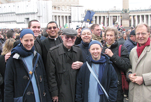 Msgr. Michael Mullen (center), pastor of St. Patrick Parish, Kansas City, Kan., helped distribute Communion to some of the thousands who attended the inauguration Mass for Pope Francis on March 19. Photo courtesy of Msgr. Mullen.