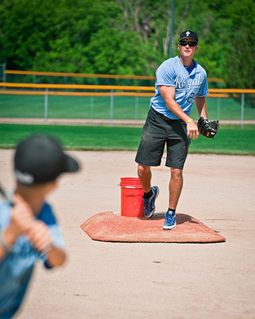 Former Kansas City Royals All-Star Mike Sweeney pitches and offers instruction at the Catholic baseball camp that bears his name. Photo by Lori Wood Habiger.