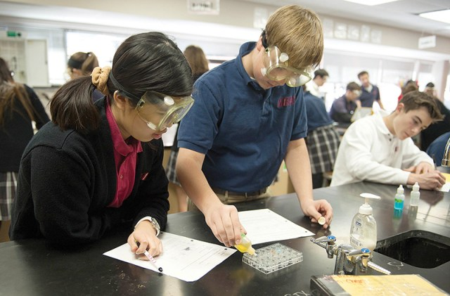From left, Bishop Miege sophomores Alyssa Yap, Luke McCool and Landry Weber work on a lab project.