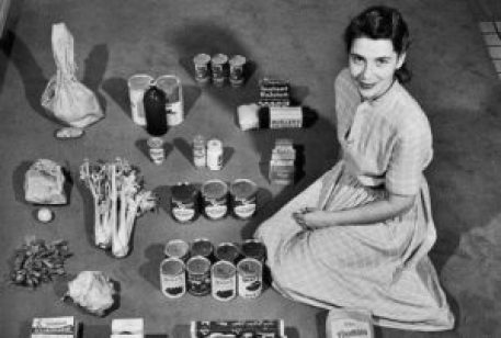 WOMAN WITH GROCERY PRODUCTS