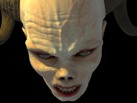 Close-up of a vampire zombie in mid attack.