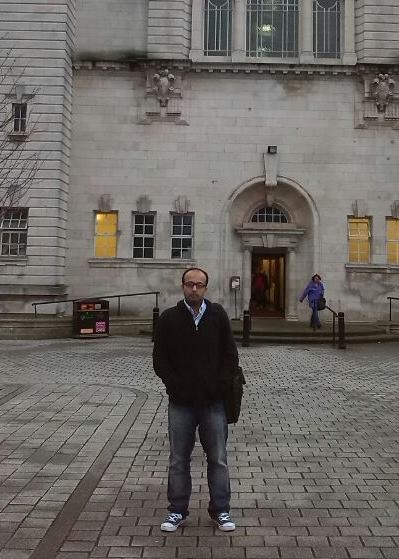 Arslan, standing outside Cardiff University.