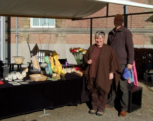 Annelies Verhijde and husband in front of silk artwork stall.