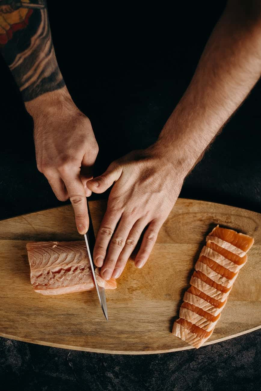 person holding silver bread knife