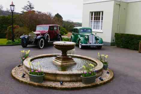 Classic cars welcome guests outside the main entrance