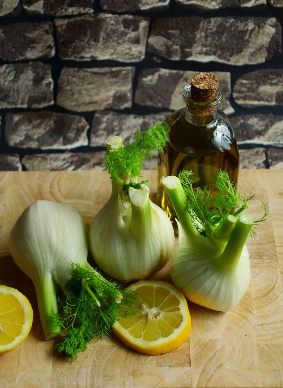 white onion with sliced lemon on beige table
