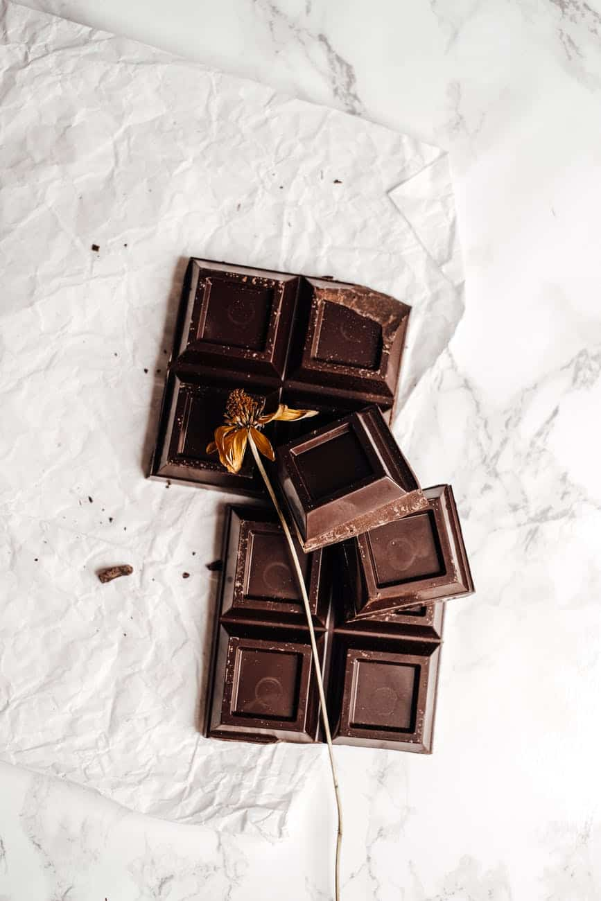photo of dried flower on top of cracked chocolate