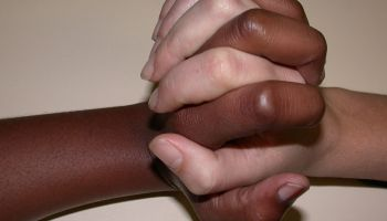 Black and white hands clasped