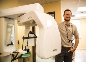 Dr Kyle Howell with the high tech Kavo dental imaging machine