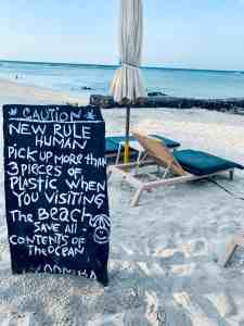 beach sign pick up trash plastic sustainability