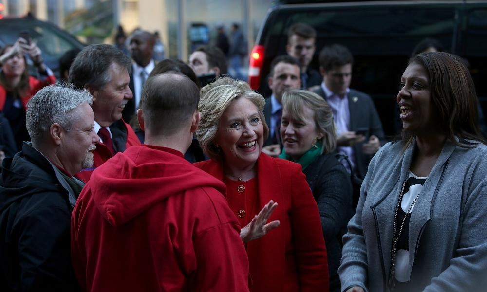 Hillary Clinton greets picketing Verizon workers outside of a Verizon store in New York City.