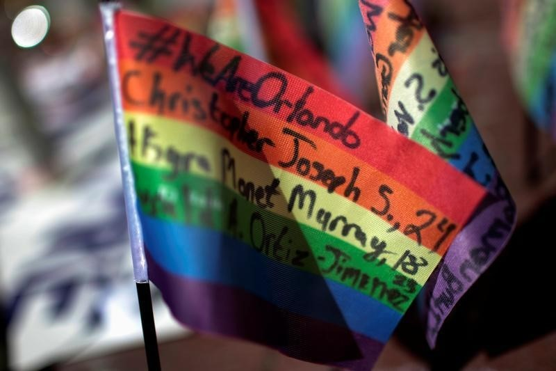 Messages written on rainbow flags are seen placed at a makeshift memorial to remember the victims of the mass shooting at a gay nightclub in Orlando, outside the Stonewall Inn in Manhattan