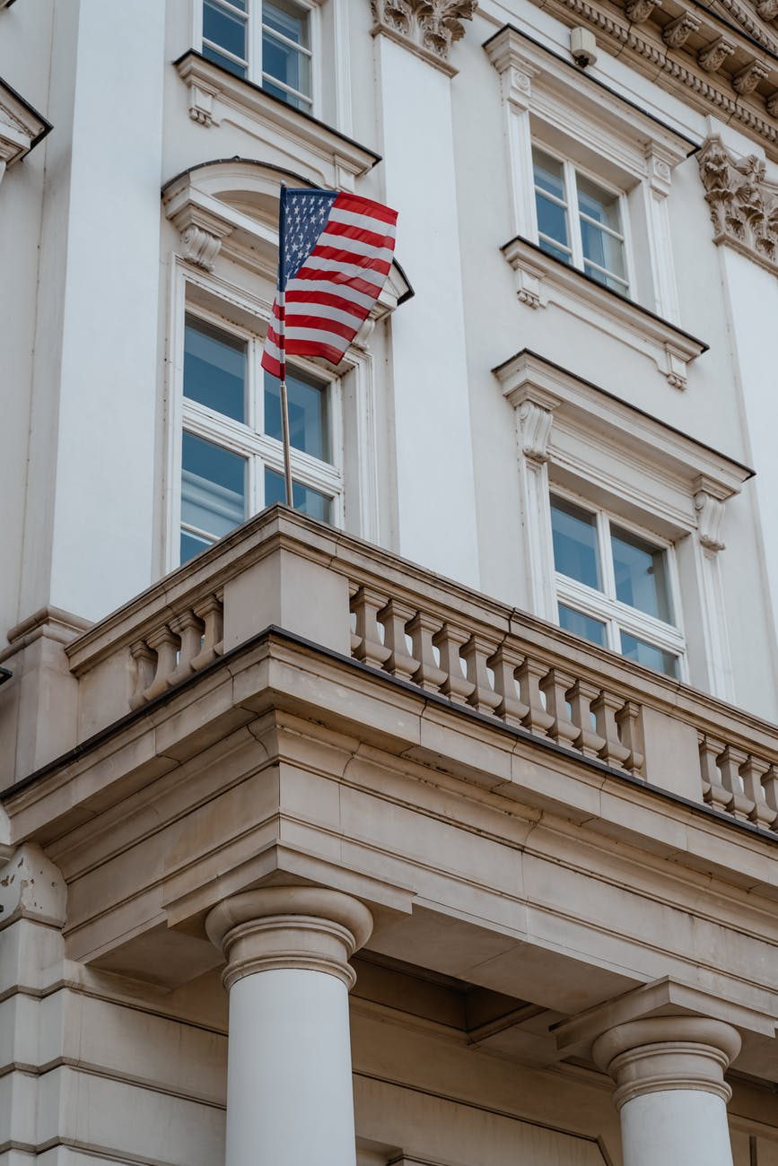 a flag waving on balcony of a building