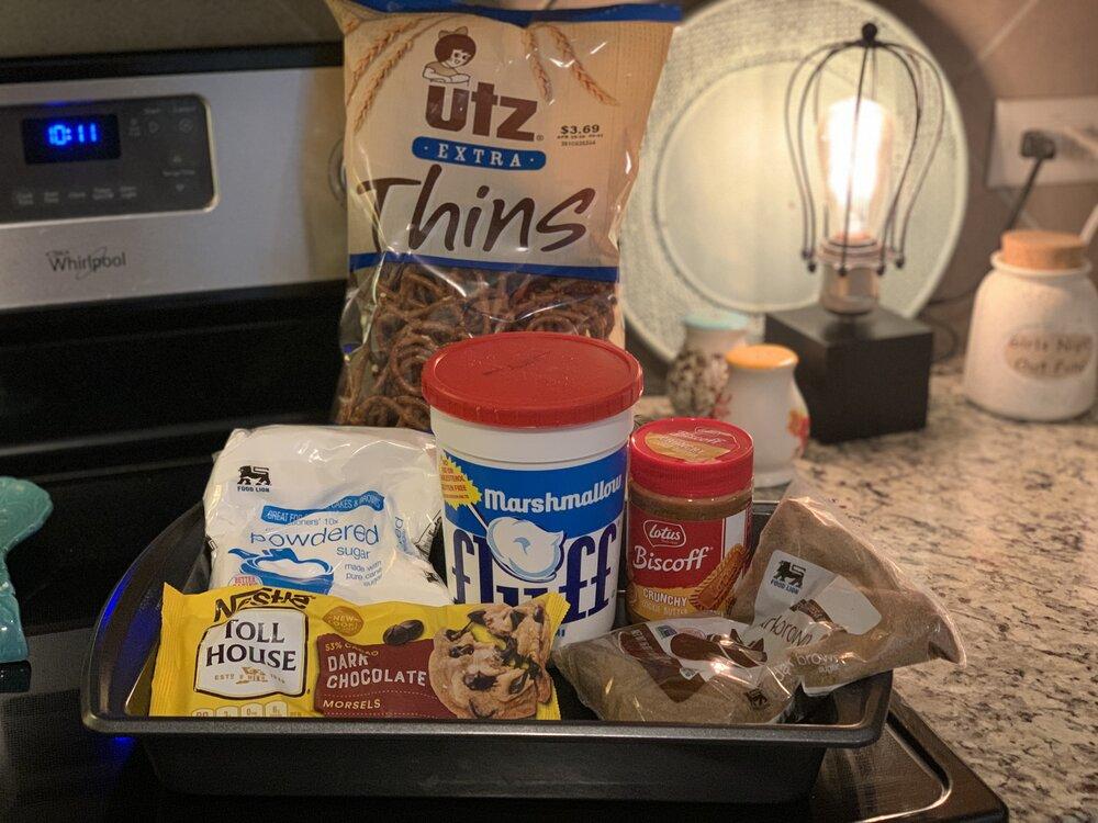 Ingredients - Marshmallow fluff, dark brown sugar, dark chocolate chips, powdered sugar, pretzels, butter and milk, and cookie butter!