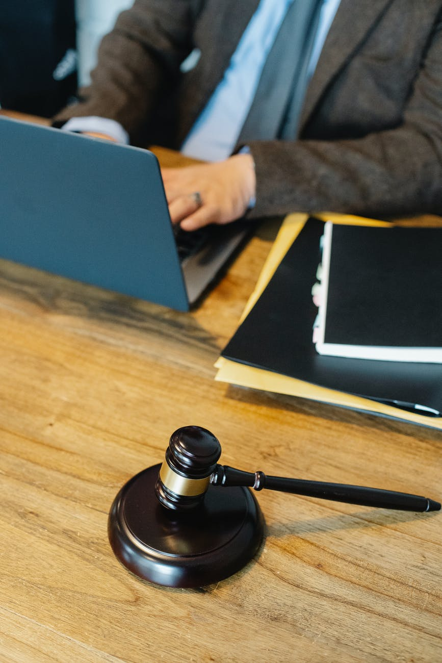 unrecognizable man working on netbook in law office