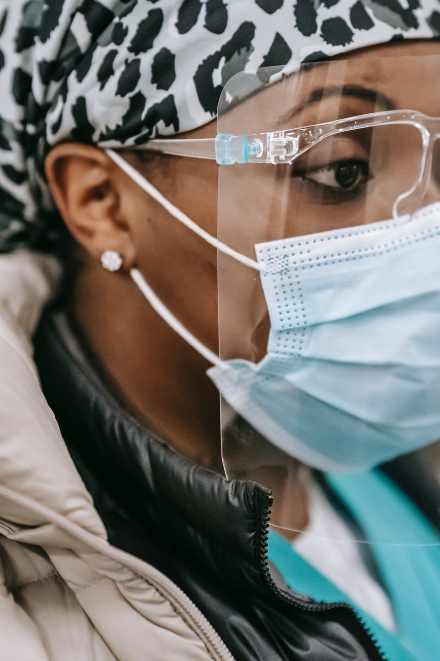 african american woman in face mask during work