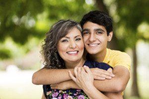 proud-mom-loving-teen-son-istock