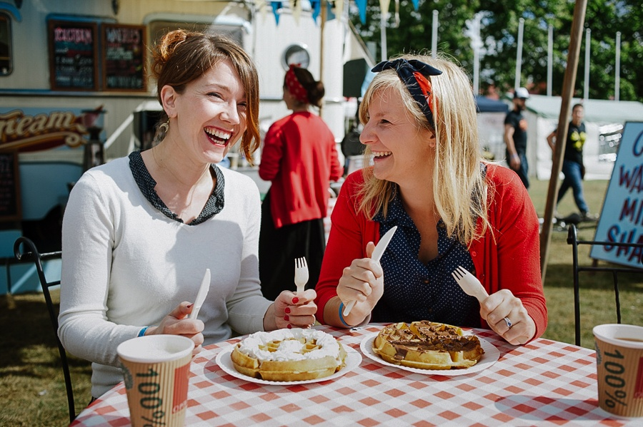 freinds laughing, eating pancakes together