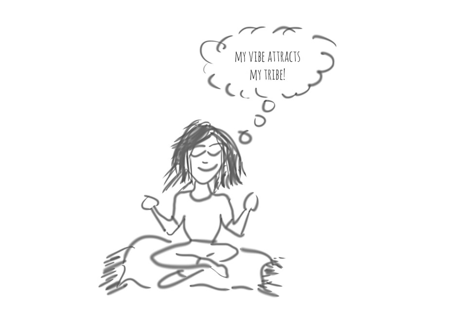 cartoon of person meditating - my vibe attracts my tribe