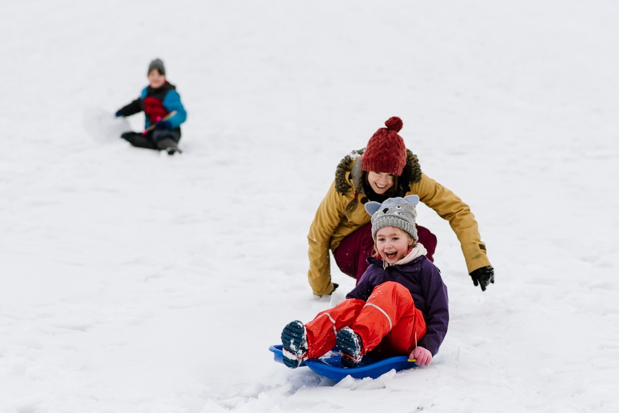 Family sledging in the snow