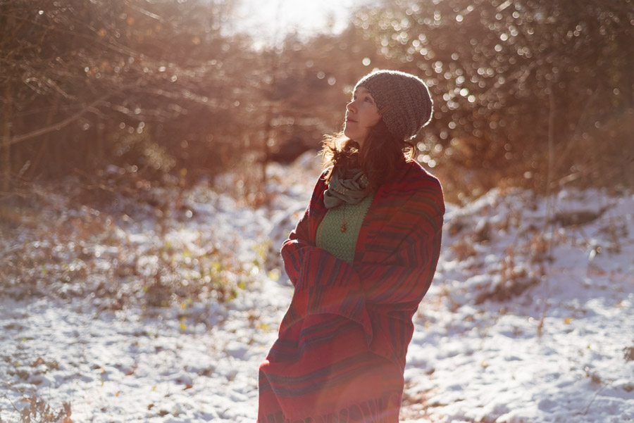Picture of a woman standing smiling in a snowy landscape on a sunny day