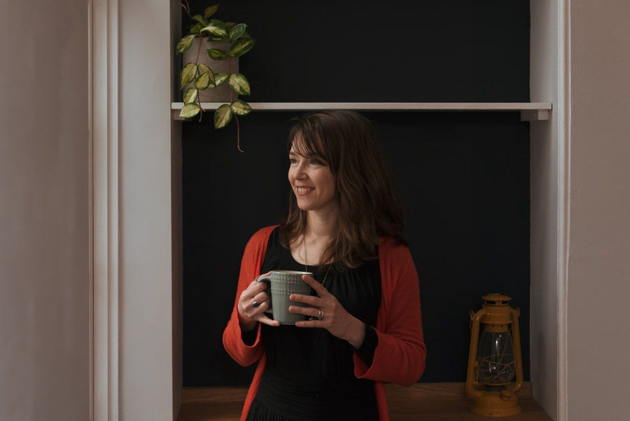 Picture of a woman pausing to enjoy a cup of something scrummy