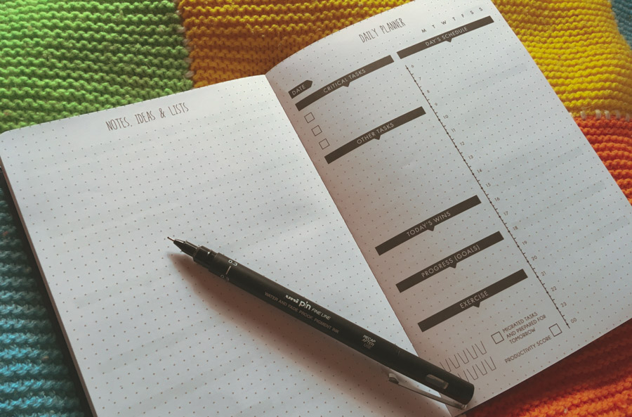 image of an open planner with a pen