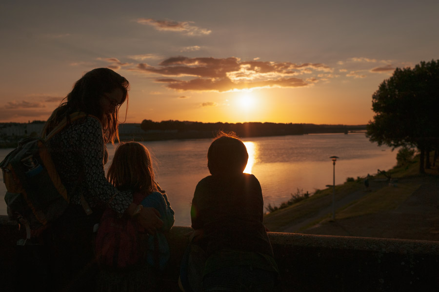 image of the uthor and her children watching the sunset over the Loire river