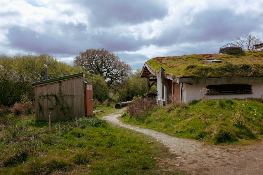 Image of cob buildings with grass roof