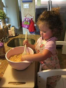 While the adults do the technical and dangerous melting. This kept the chef busy. The important job of mixing the rice crispier. She was in heaven x