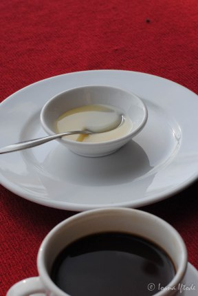 """An Asian """"white coffee"""" - the white liquid is the milk, sweet and thick :)"""