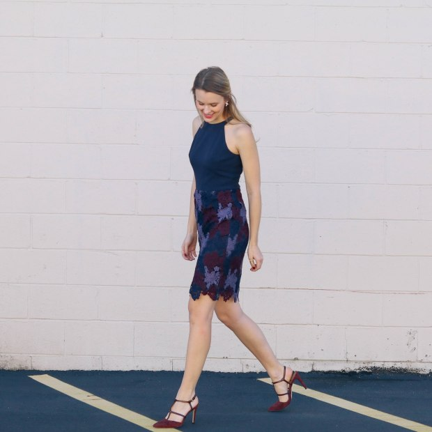 End of November seasonal style with tri-color lace of burgundy, navy and purple embodying the rich hues of autumn as a cinched-waist sheath dress.