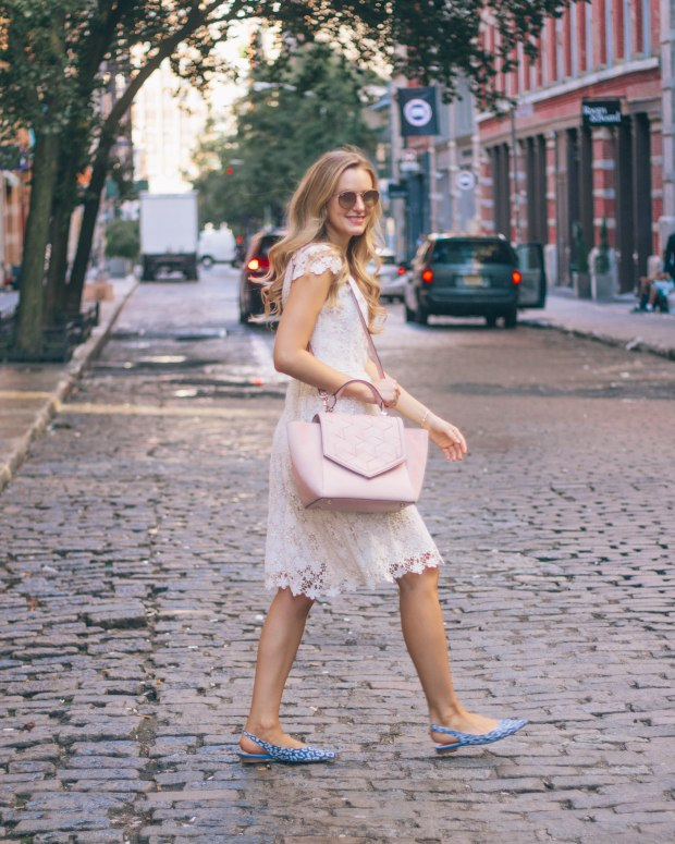 Style blogger, Leigha Gardner of The Lilac Press, wearing a little white lace dress, blush leather tote and statement shoes in NYC.