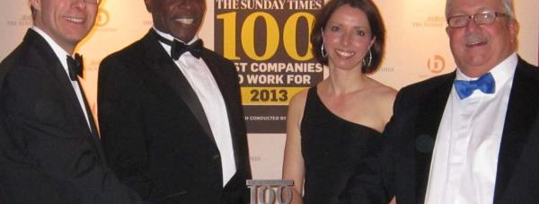 Lindum employees Ayo Odeyingbo, Jo Holmes and Arthur Fox receiving the award from Best Companies Director