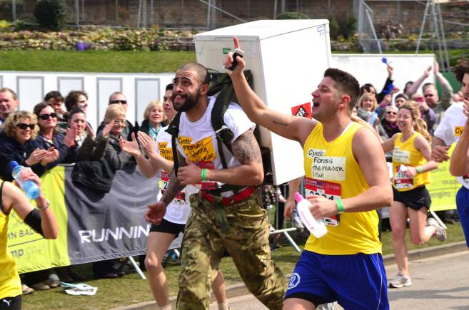 Physical training instructor Iain Maynard ran with a 40kg fridge strapped to his back to raise money for the Cystic Fibrosis Trust as his 20-month-old daughter Halle has the condition. Photo: Steve Smailes for The Lincolnite