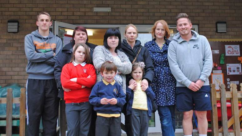 Staff at Nettleham Timeout Club along with parents and their children, who are unhappy the club has to close in June. Club owner Jo O'Neill is pictured second from the right.