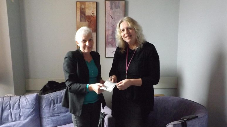 Mrs Sheila Berry presenting the cheque to Joanne Divver, Macmillian Breast Care Nurse Specialist