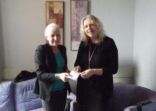 Mrs Sheila Berry presenting the cheque to Joanne Divver, Macmillian Breast Care Nurse Specialist